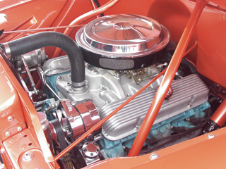 A mild Pontiac 350 was rebuilt & fitted with an Edelbrock Performer intake and carb.